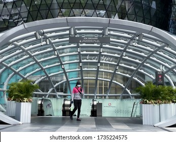 Singapore May2020 An essential food delivery person in Orchard Road, now unusually quiet during circuit breaker period as tourism is affected & people stay at home; coronavirus covid-19 outbreak