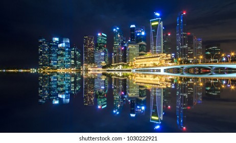 Singapore Night Cityscape And Reflection  On Water