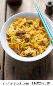 Singapore noodles, stir-fried noodles, chicken breast with egg, mixed greens in curry sauce