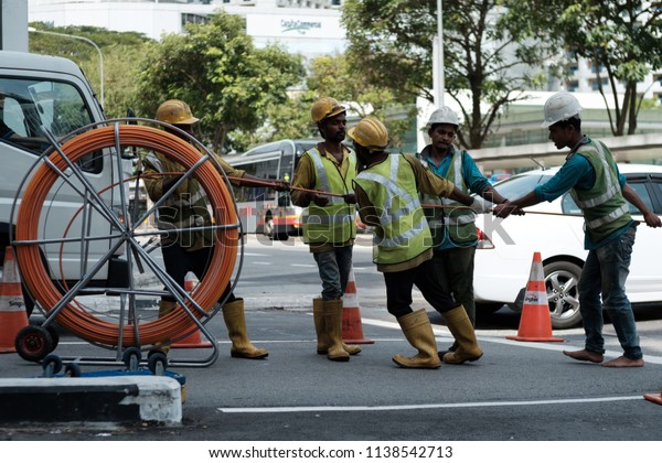 Singapore, Singapore Nov 03 2017 : Workers working hard to maintain cables