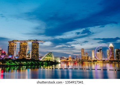 SINGAPORE - NOV 19, 2018 : Night View of the Marina Bay Sands Resort and Gardens by the Bay along Singapore River on sunset. This waterfront conservatory is a big tourist attraction.