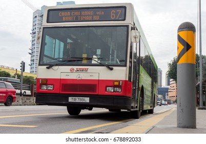 SINGAPORE, NOV 22 2014, The city bus arrives at the station. Public transport in the city Singapore.