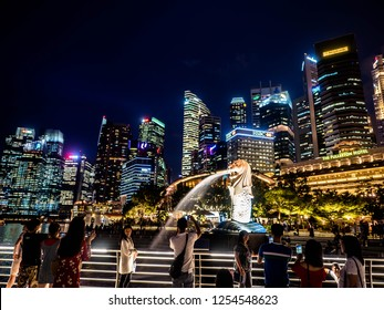 SINGAPORE - NOV 22, 2018: View of the business district and The Merlion is the national personification of Singapore. The Merlion was first used in Singapore as the logo for the tourism board.