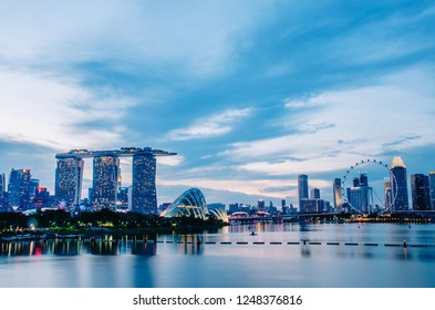 SINGAPORE - NOV 24, 2018 : Night View of the Marina Bay Sands Resort and Gardens by the Bay along Singapore River on sunset. This waterfront conservatory is a big tourist attraction.