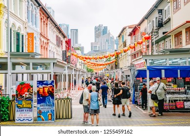 SINGAPORE - NOV 25, 2018: Chinatown with notable Chinese buildings, restaurants and decoration. Many tourists find there authentic food, clothes and other stuff and people engaging in daily activity.