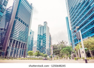 Singapore - NOV 25 2018: Singapore landscape with cars on street and high business buildings on backgroud