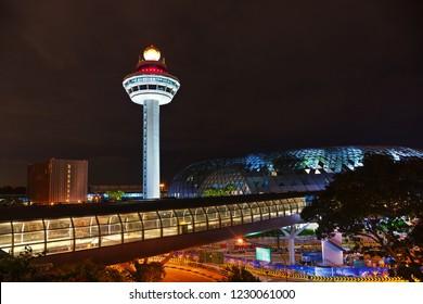 SINGAPORE - NOVEMBER 02: Changi airport control tower at night on November 02, 2018 in Singapore.