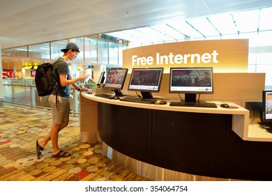 SINGAPORE - NOVEMBER 04, 2015: man use computer in Changi Airport. Singapore Changi Airport, is the primary civilian airport for Singapore