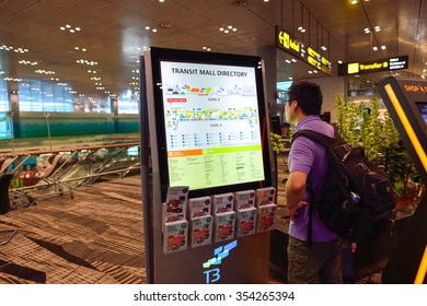 SINGAPORE - NOVEMBER 04, 2015: passenger in Changi Airport. Singapore Changi Airport, is the primary civilian airport for Singapore, and one of the largest transportation hubs in Southeast Asia