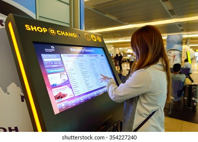 SINGAPORE - NOVEMBER 09, 2015: passenger in Changi Airport. Singapore Changi Airport, is the primary civilian airport for Singapore, and one of the largest transportation hubs in Southeast Asia