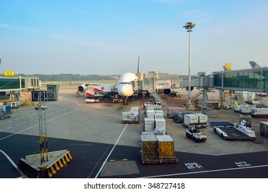 SINGAPORE - NOVEMBER 10, 2015: A380 docked at Changi Airport. Singapore Changi Airport, is the primary civilian airport for Singapore, and one of the largest transportation hubs in Southeast Asia