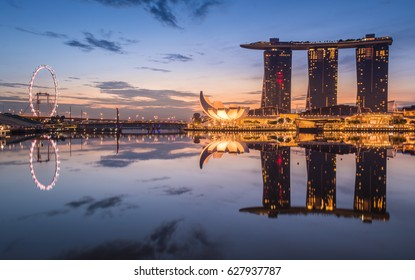 Singapore - November 13, 2016 : Singapore business district skyline with sunrise in morning at Marina Bay, Singapore.