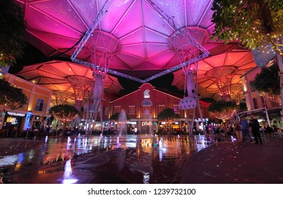 SINGAPORE - NOVEMBER 15, 2018: Unidentified people visit Clarke Quay riverside shopping complex in Singapore