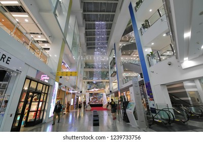 SINGAPORE - NOVEMBER 15, 2018: Unidentified people visit Clarke Quay Central mall Singapore. Clarke Quay Central is a contemporary shopping mall in Clark Quay MRT station opened in 2008