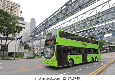 SINGAPORE - NOVEMBER 17, 2018: Public bus drives through downtown Singapore.
