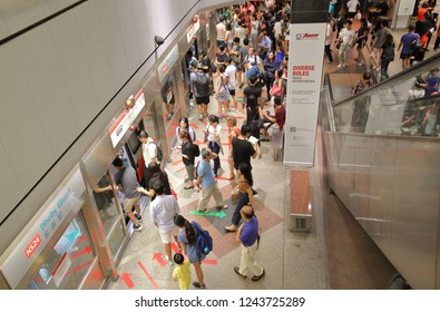 SINGAPORE - NOVEMBER 17, 2018: Unidentified people travel by MRT subway at Clarke Quay station Singapore.