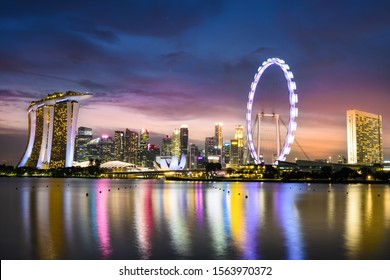 Singapore, November 17, 2019. Skyline of Singapore with the Marina Bay Sands Luxury Hotel and the Singapore Flyer during a stunning sunset. Singapore is an island city-state off southern Malaysia.