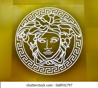 SINGAPORE - NOVEMBER 18, 2015: close us shot of Versace logo on the wall. Versace, is an Italian fashion company and trade name founded by Gianni Versace in 1978