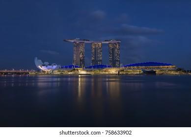 Singapore, Singapore - November 19, 2017: Marina Bay Sands Hotel. Art and Science Museum and Helix Bridge in the evening, Marina Bay, Singapore