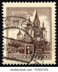 SINGAPORE - NOVEMBER 19, 2017: A stamp printed in Austria shows image of the Austrian city of Mariazell, series, circa 1959