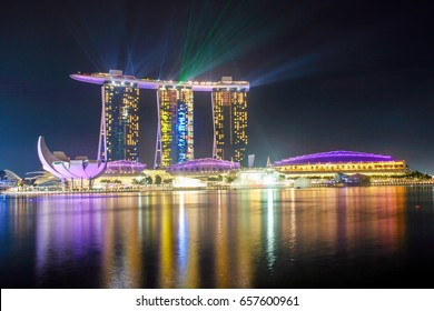 SINGAPORE - NOVEMBER 20, 2012 - Marina Bay Sand at night with colorful lighting from a laser show