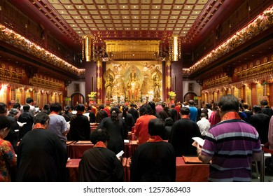 Singapore, Singapore - November 20, 2018: Worshippers Pray At a Ceremony Inside the Hall of Wisdom at the Temple of the Sacred Tooth of Buddha in China Town on November 20, 2018 in Singapore