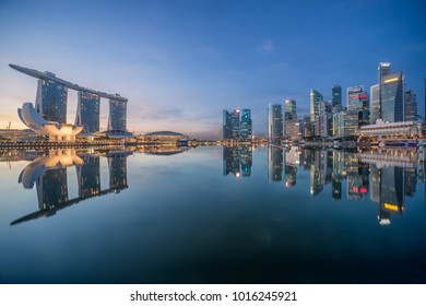 Singapore - November 21, 2014: Singapore City Skyline in the morning. Office buildings on the right, together with the Fullerton Hotel and the Marina Bay Sands Hotel and Art Science Museum at the left