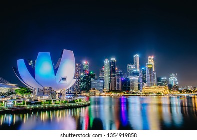 Singapore, November 24, 2018 : Singapore cityscape at dusk. Landscape of Singapore business building around Marina bay. Modern high building in business district area at night.