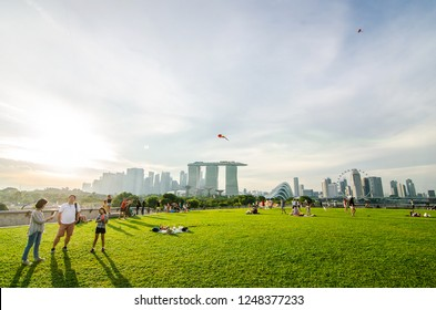 SINGAPORE - NOVEMBER 25, 2018:Top View of the Marina Barrage roof top in the evening. Marina Barrage is a place of recreation, proving especially popular for picnics and kite flying.
