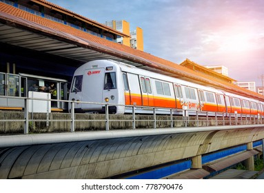 SINGAPORE - NOVEMBER 30, 2017: Singapore mass rapid train (MRT) travels on the track. The MRT has 106 stations and is the second-oldest metro system in Southeast Asia.