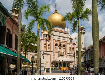 SINGAPORE - NOVEMBER 6: View along Bussorah Street to the Sultan Mosque, centre of islamic culture and traditions as well as most important mosque in Singapore. November 6, 2012 in Singapore.