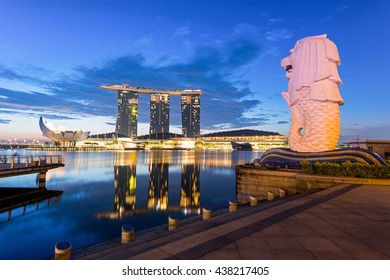 SINGAPORE - NOVEMBER 7, 2014: The Merlion statue fountain and the Singapore skyline. The landmark statue is considered the personification of Singapore.