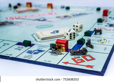 Singapore - November 7, 2017:  Monopoly Board Game with the car passing the GO. The classic real estate trading game from Parker Brothers was first introduced to America in 1935.