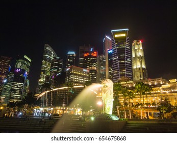 Singapore, Singapore - Oct 10, 2011: Merlion statue fountain and city skyline at night. This place is famous tourist attraction in singapore