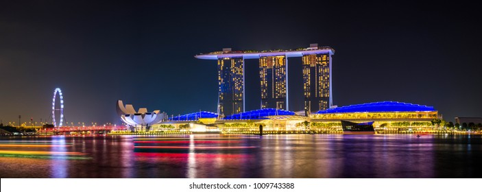 Singapore - Oct 19, 2017: Aerial Panorama View of Singapore Signature Place, Marina Bay Sands, Singapore Flyer and Light Trails of Boats in the Marina Bay, Singapore.