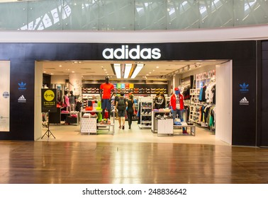 SINGAPORE - OCT 19 : Adidas Store at ION Orchard shopping mall on October 19, 2014. It's Is a German multinational corporation that designs and manufactures sports clothing based in Germany.