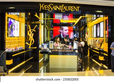 SINGAPORE - OCT 19 : Yves Saint Laurent Store at ION Orchard shopping mall on October 19, 2014.YSL is a famous luxury fashion brand founded in 1962. It had 473 million EUR revenue in 2012.