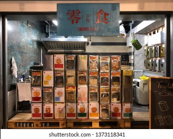 Singapore, Singapore - Oct 2018: An ancient shopfront with tins of traditional singapore biscuits stacked up at FOMO Singapore located in Bugis.