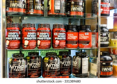 SINGAPORE OCT 25, 2015: Workout supplement, sport nutrition, bodybuilding supplements, sport diet power, whey, and soy and egg protein, chemistry on display on shelves in a Pharmacy