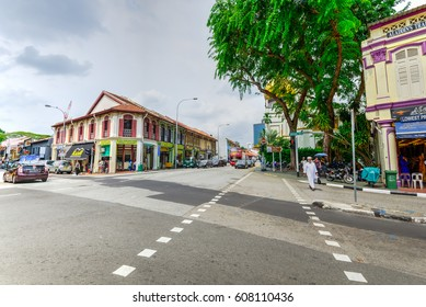 SINGAPORE - OCT 31, 2015: Street view busy Arab street in Kampong Glam area, row of historical old style double storey shop houses, a walking Islamic payer, and dome of Masjid Sultan ( Sultan Mosque).