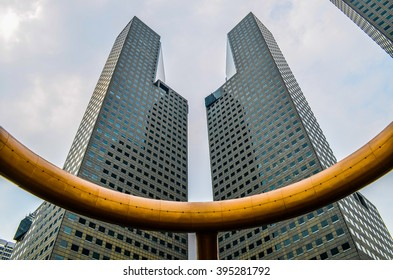 SINGAPORE - Oct 7, 2014: Two towers of Suntec City. Suntec City was designed by Tsao & McKown Architects with emphasis on Chinese geomancy.