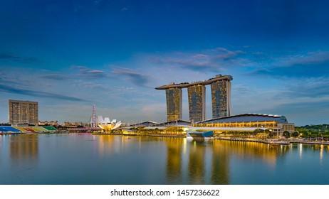 SINGAPORE, SINGAPORE - OCTOBER 08: Singapore cityscape at dusk. Landscape of Singapore of buildings around the Marina Bay complex.