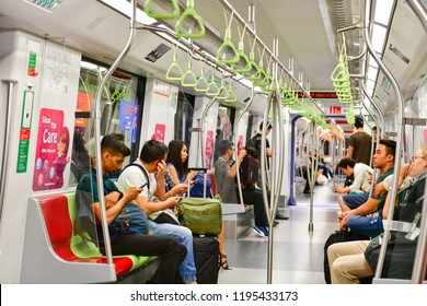SINGAPORE -OCTOBER 1,2018: Passengers in a Mass Rapid Transit (MRT) subway train in Singapore
