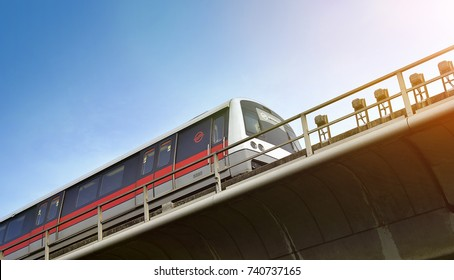 SINGAPORE - OCTOBER 15, 2017: Singapore mass rapid train (MRT) travels on the track. The MRT has 106 stations and is the second-oldest metro system in Southeast Asia.