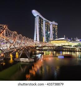 SINGAPORE - OCTOBER 16, 2014: Marina Bay Sands and Helix Bridge at sunset.