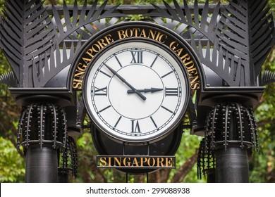 SINGAPORE - OCTOBER 17, 2014: Old Clock in The Singapore Botanic Gardens.