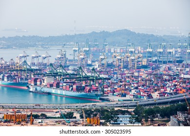 SINGAPORE - OCTOBER 18, 2014: The port of Singapore. It's the world's busiest transshipment port and the world's second busiest port in terms of total shipping tonnage.