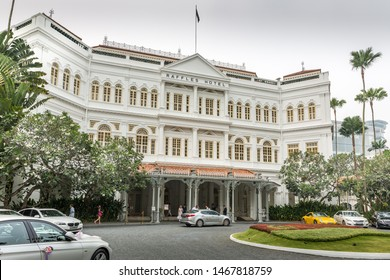 Singapore - October 18th 2015: The grand facade & exterior at the entrance to Raffles Hotel, a colonial-style luxury hotel named after British statesman Sir Thomas Stamford Raffles in Singapore, Asia