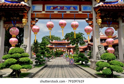 Singapore - October 2 2017: The gateway to the famous Siong Lim Buddhist Temple in Singapore decorated with pink lanterns