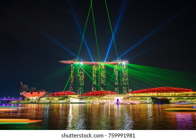 SINGAPORE - OCTOBER 21, 2017: Marina Bay Sands during Light and Water Show one of the most tourist attractions in Singapore